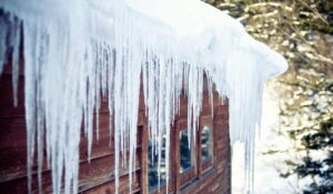 snow and ice damming on maximum altitude roof in flagstaff